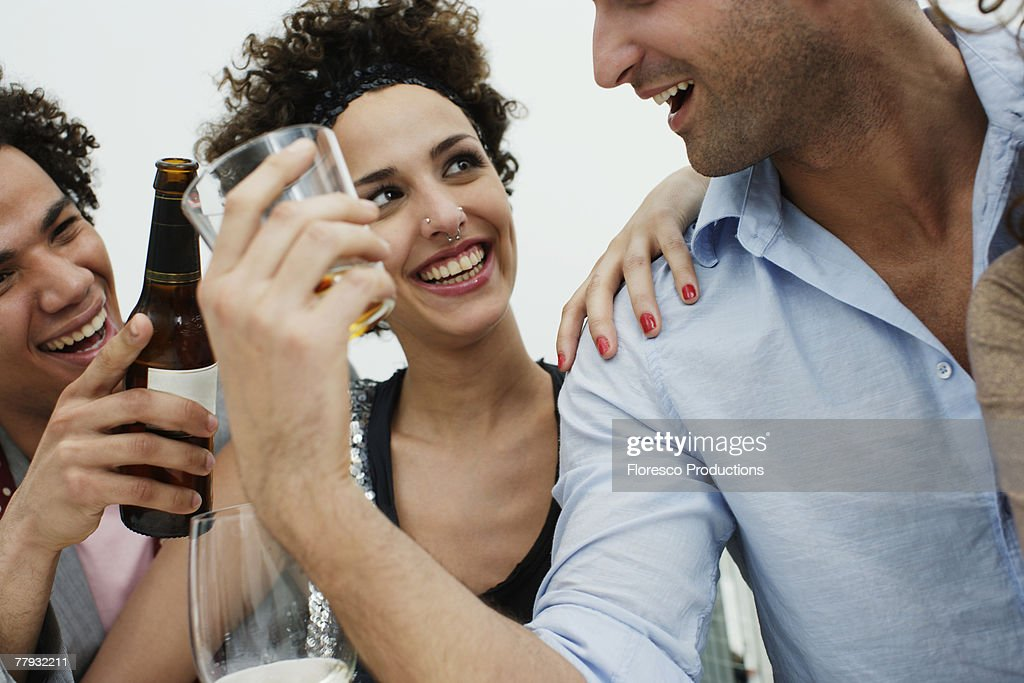 Four friends drinking indoors : Stock Photo