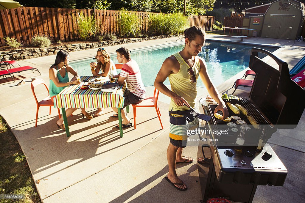 Four friends enjoying a day at the pool. : Stock Photo