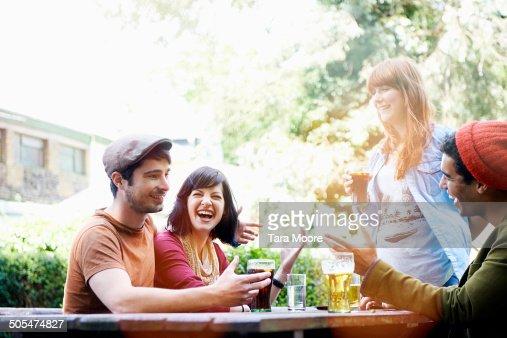 four friends having fun in beer garden
