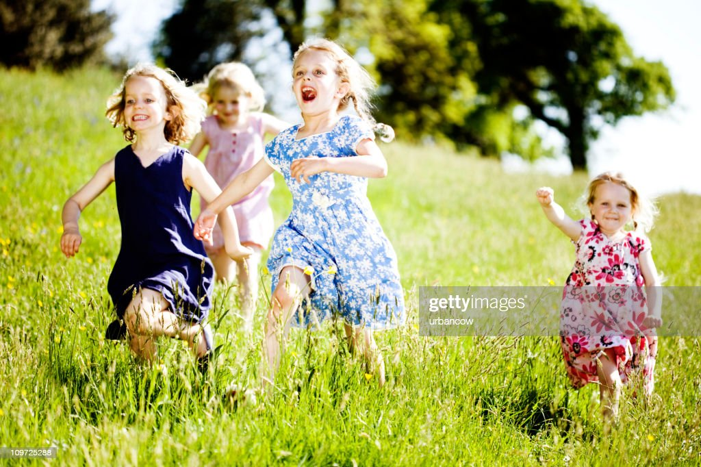 Four friends playing : Stock Photo