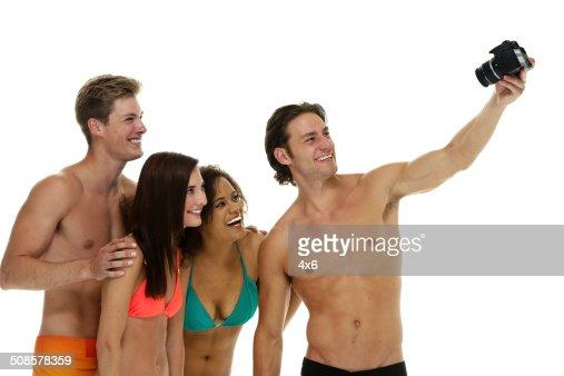 Four friends taking selfie : Stock Photo
