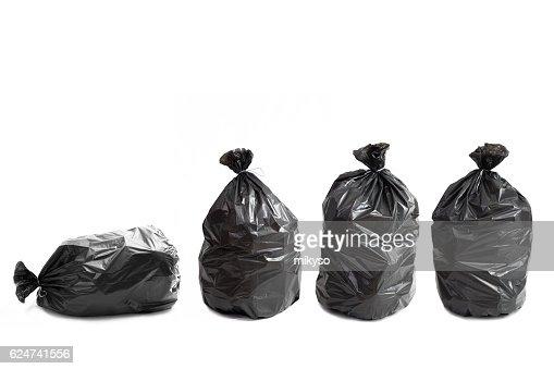 Four garbage bags : Stock Photo