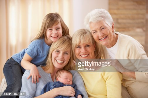 Four generation family of females, smiling, portrait