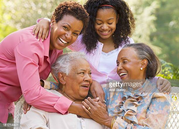 Four generations of Black women smiling