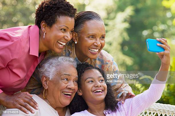 Four generations of Black women taking picture