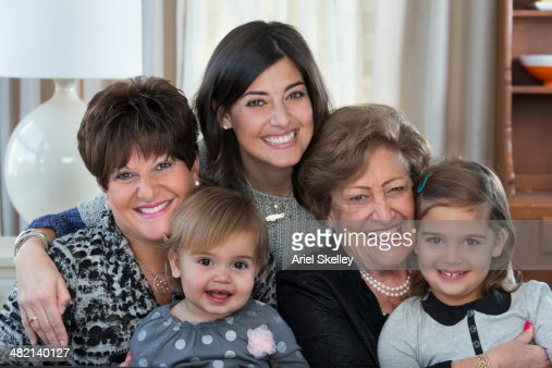 Four generations of women smiling together