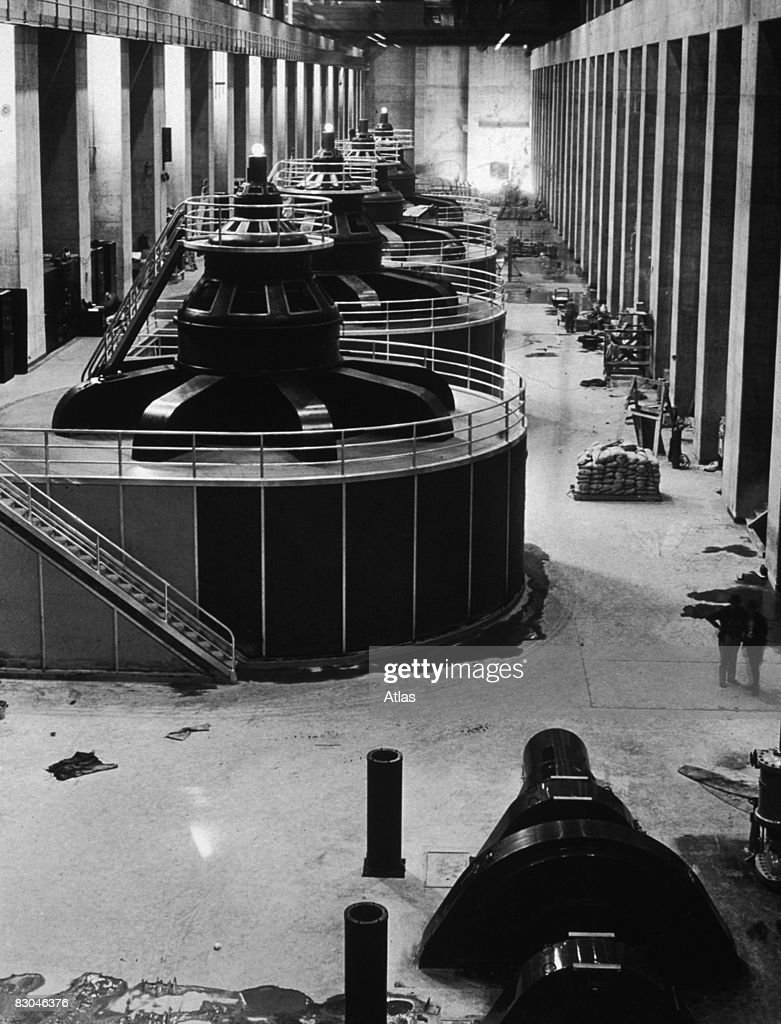 Four generators, each of 82,500 kilovolt ampere capacity, in the Nevada wing of the Boulder Dam (now Hoover Dam) during its construction, circa 1935.