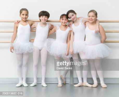 Four Girls And Boy With Arms Around Each Other In Ballet