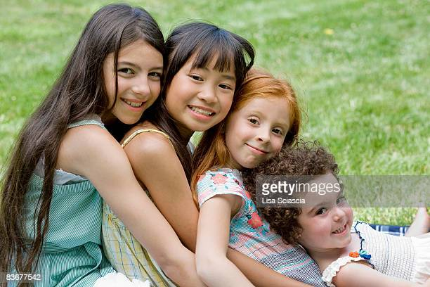 Four girls leaning on each other