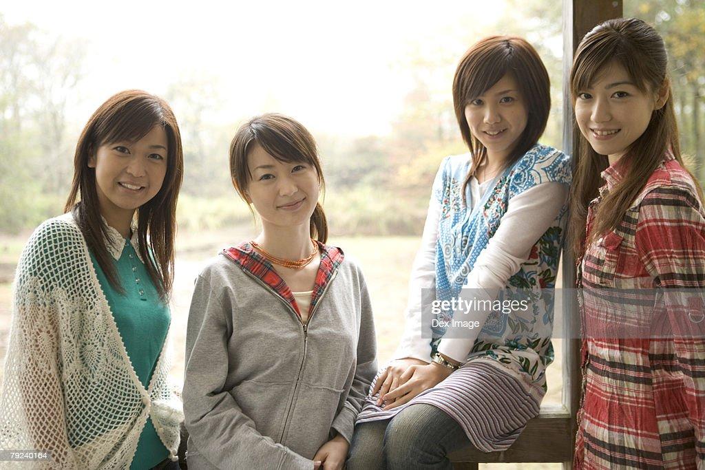 Four girls, smiling : Stock Photo
