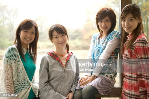 Four girls, smiling : Stock Photo