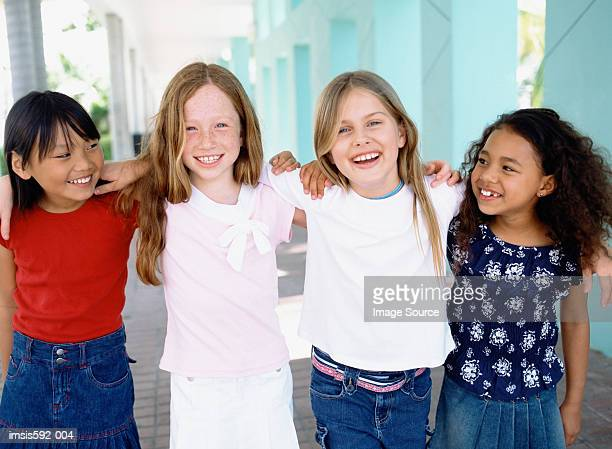 Four girls smiling