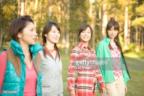 Four girls strolling in the park : Stock Photo