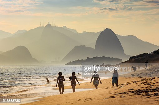 Four Girls Taking a Walk at the Beach by Sunset