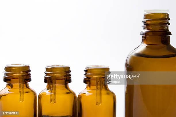 Four glass bottles