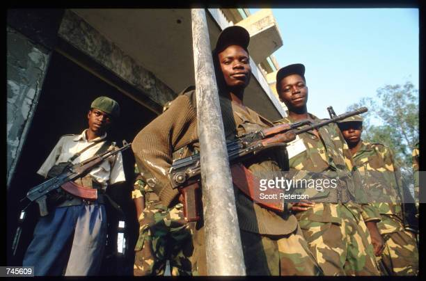 Four government soldiers pose with weapons October 25 1993 in Menogue Angola Angolan rebels have continued the civil war after losing elections in...