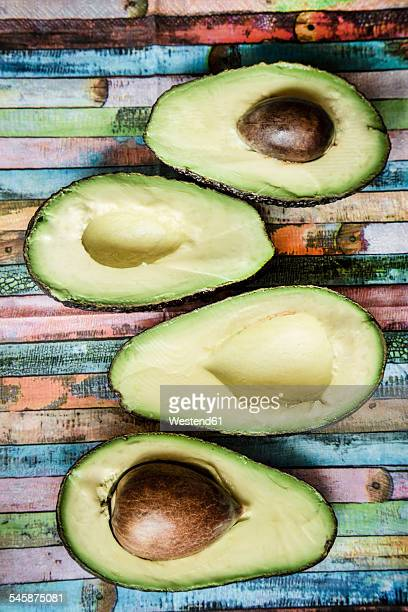 Four halves of avocados