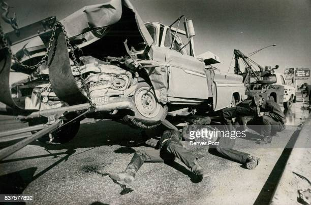 Four Injured in Threevehicle crash A vehicle is ready to be towed away Monday following a j threevehicle accident that injured four persons two...