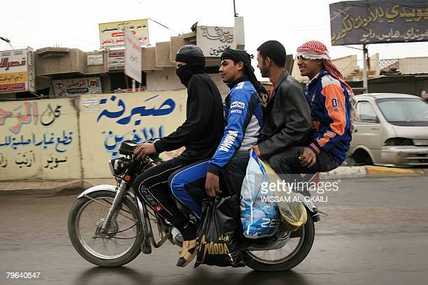 Four Iraqi youth ride a motorcycle at Baghdad's Palestine street on February 8 2008 Despite restrictive measures from Iraqi authorities on the use of...