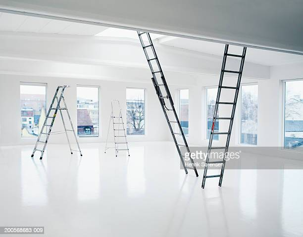 Four ladders in empty apartment