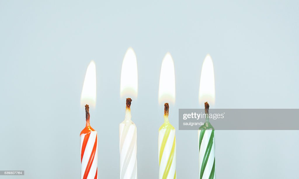Four lighted birthday candles