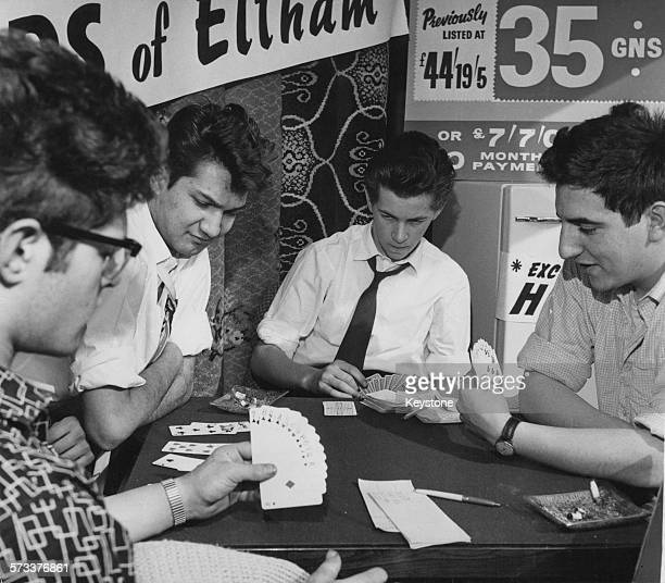 Four London University students attempting to break the world record for nonstop bridge playing in the window of a department store in Eltham...