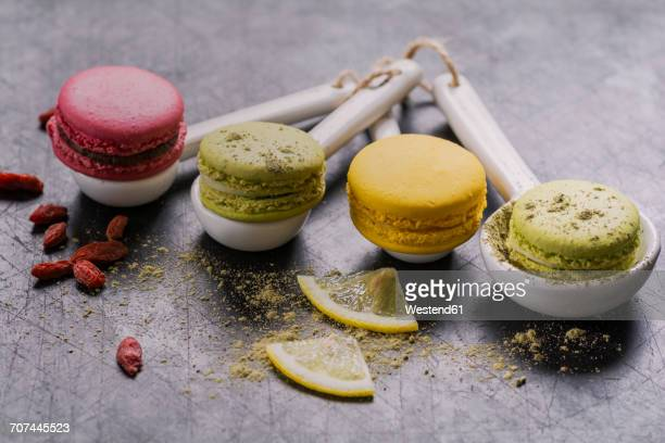 Four macarons on porcellain spoons