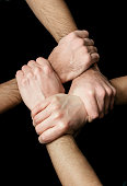 4 male hands linked at the wrist,sidelighting,detail in hands
