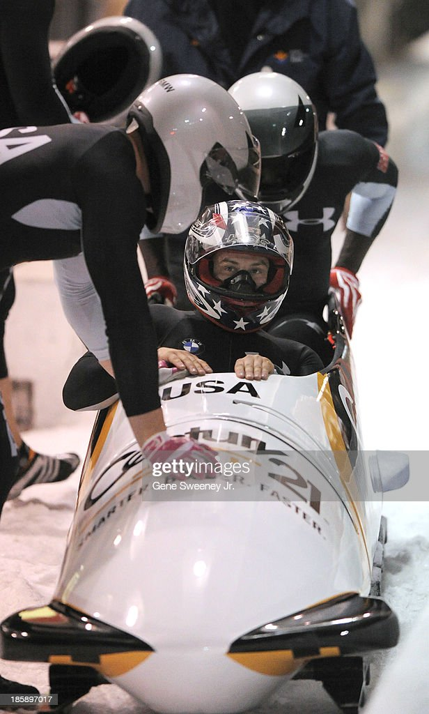 USA four man bobsled pilot <a gi-track='captionPersonalityLinkClicked' href=/galleries/search?phrase=Nick+Cunningham&family=editorial&specificpeople=4233037 ng-click='$event.stopPropagation()'>Nick Cunningham</a> looks at his time as he and his teammates finish their second run during the bobsled selection runs at the Utah Olympic Park October 25, 2013 in Park City, Utah. Their combined time placed them second.