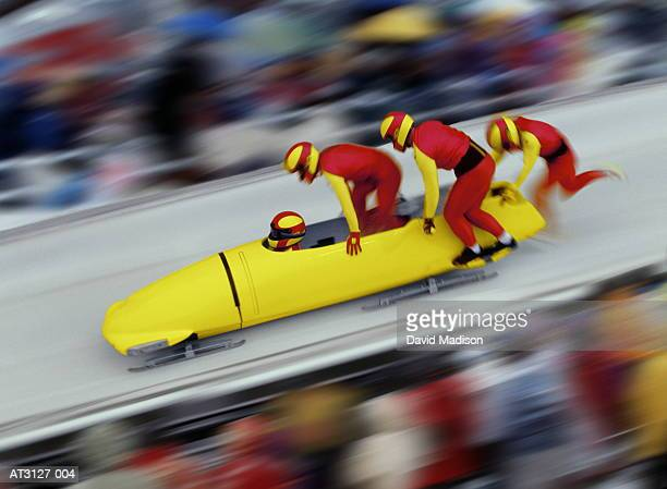 Four man bobsleigh team at top of competition slope (Composite)