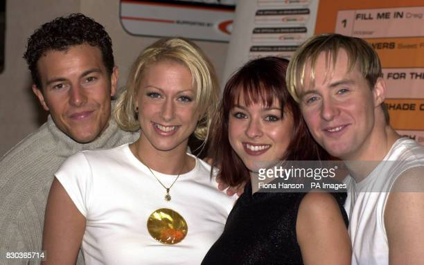 Four members of pop band Steps Ian Watkins Faye Tozer Lisa ScottLee and Lee Latchford during the launch of Worldpop's sponsorship deal with the...