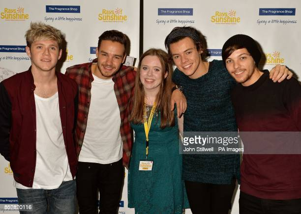 Four members of the boy band One Direction Niall Horan Liam Payne Harry Styles and Louis Tomlinson with fan Elena Byrne from Strabane in Northern...