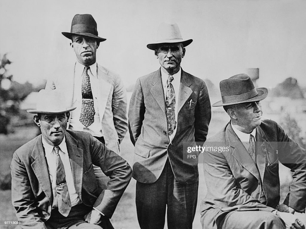 Four members of the six-man posse, who ambushed and killed fugitive criminals Clyde Barrow and Bonnie Parker near Gibsland, Louisiana on 23rd May 1934. They are pictured on the day following the ambush. Left to right: Dallas County Sheriff's Deputies Bob Alcorn (1897 - 1964) and Ted Hinton (1904 - 1977) and former Texas Rangers B.M. 'Manny' Gault (1896 - 1947) and Captain Frank Hamer (1884 - 1955).