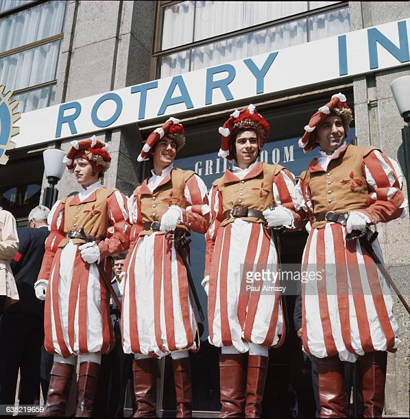 Four men dressed in traditional Swiss guard uniforms stand outside the Rotary International Convention in Lausanne Switzerland