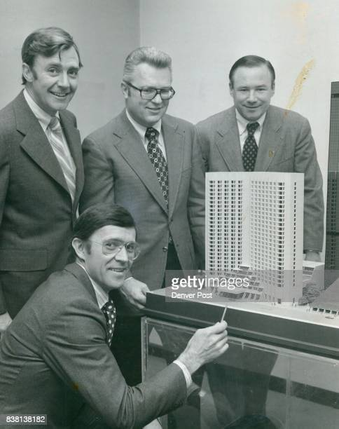 Four men who will play major roles in its construction are shown with scale model of the 31story hotel that will be built on Welton Street between...