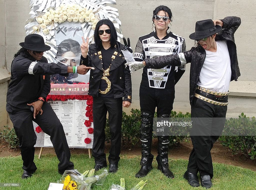 Four Michael Jackson impersonators pose outside of Jackson's mausoleum at the Forest Lawn Memorial Park cemetery in Glendale California on the 5th...