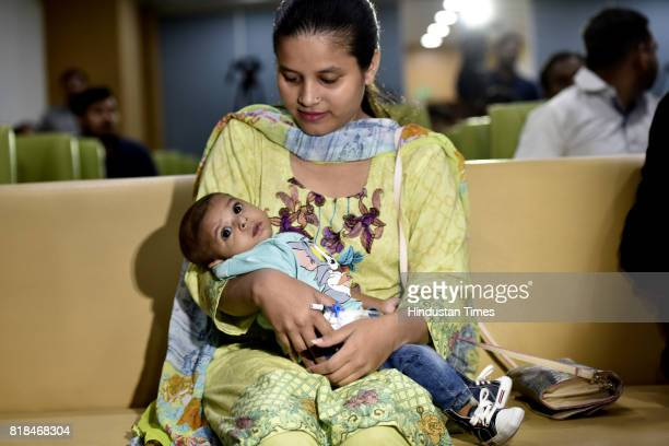 Four Month old Pakistani boy Rohaan with his mother Anam after successful surgery at Jaypee Hospital on July 18 2017 in Noida India The boy underwent...