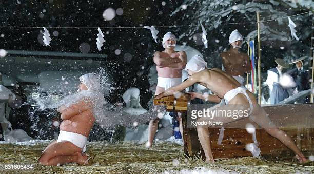 Four nearly naked men aged 15 to 25 splash cold water over each other in temperatures of minus 5 C and snow during a Shinto ritual dating back to...