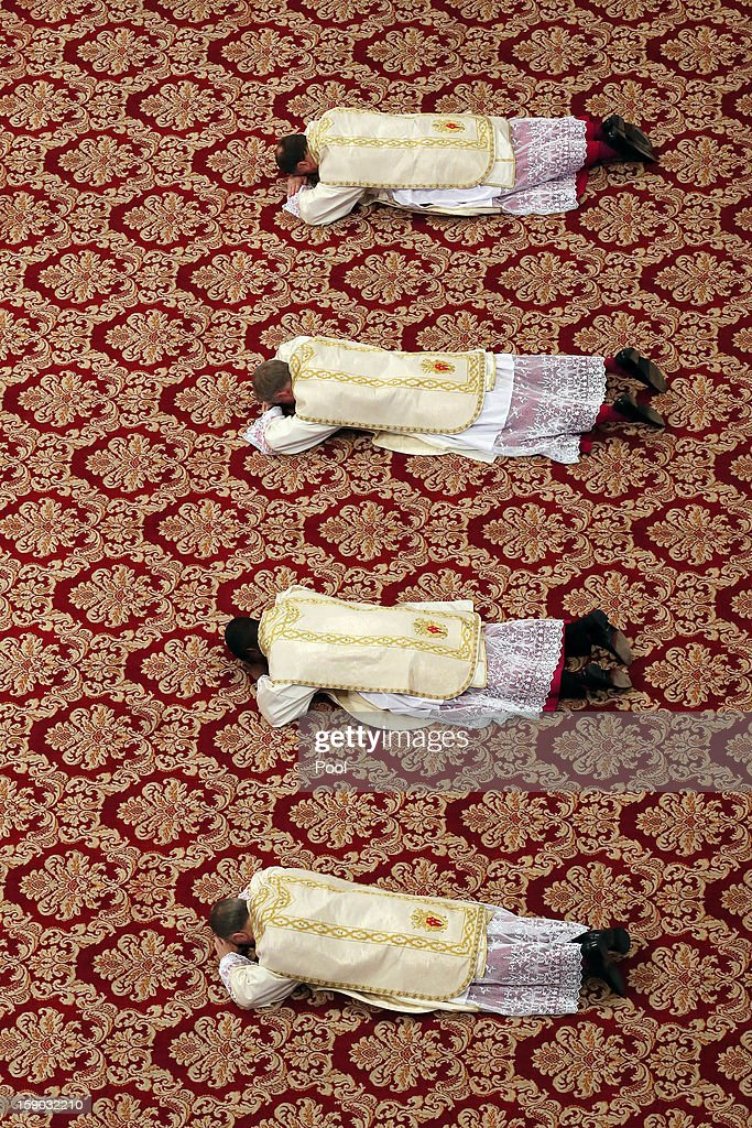 Four newly named bishops by Pope Benedict XVI attend the Epiphany Mass at the St. Peter's Basilica on January 6, 2013 in Vatican City, Vatican. During the ceremony the pontiff named four new bishops including his personal secretary Georg Gaenswein.