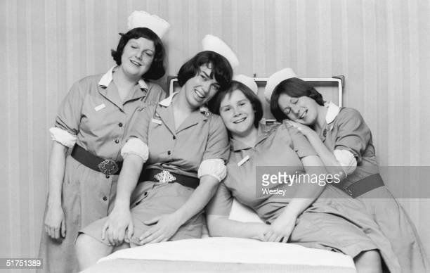 Four nurses at Addenbrooke's Hospital Cambridge shortly after setting a new world record for bed making with 66 beds in 30 minutes 11th January 1978...