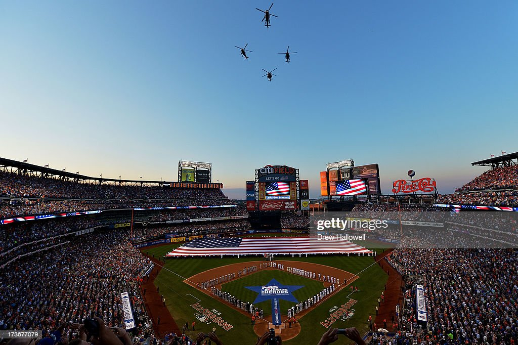 Four NYPD's Aviation Unit helicopters flyover while the national anthem of the United States is sung as the flag covers the field before the 84th MLB All-Star Game on July 16, 2013 at Citi Field in the Flushing neighborhood of the Queens borough of New York City.