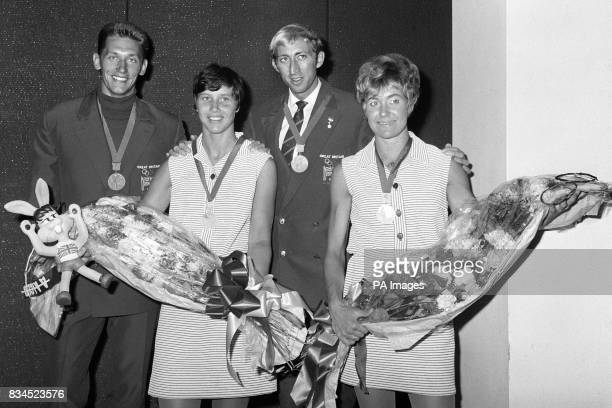 Four of Britain's Olympic medal winners left to right John and Sheila Sherwood David Hemery sand Lillian Board with their medals Athletic Alfie...