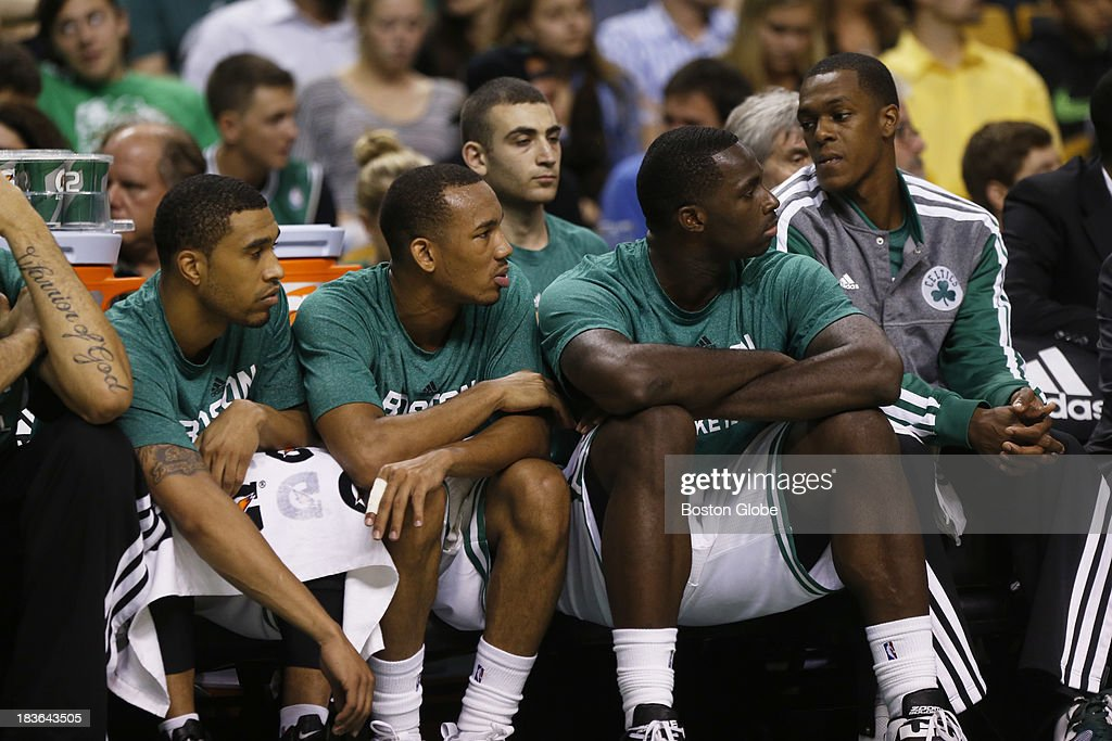Four of last year's Celtics, from left Courtney Lee (#11), Avery Bradley (#0), Brandon Bass (#30) and Rajon Rondo (#9) watched the game. The Boston Celtics play the Toronto Raptors in the Celtics' first NBA preseason game at TD Garden in Boston, MA on Monday, October 7, 2013. (Yoon S. Byun/Globe Staff) Slug: celtics Reporter: baxter holmes