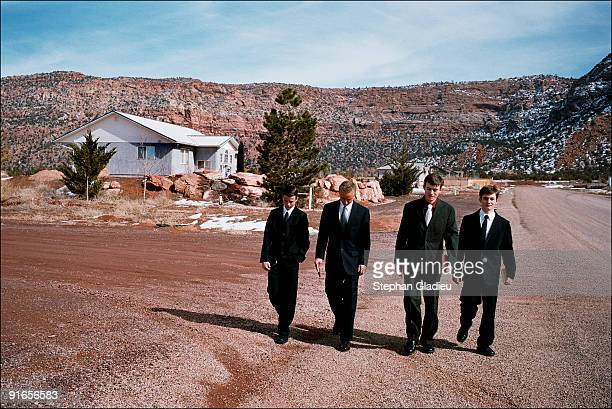 Four of Ray Timpson's sons on their way to Sunday church in Centennial Park a small polygamist community located at the border of Utah and Arizona...