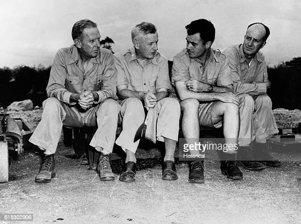 Four of the men closely involved with the delivery of the atomic bomb to Hiroshima sit for a portrait From left to right Rear Admiral William R...