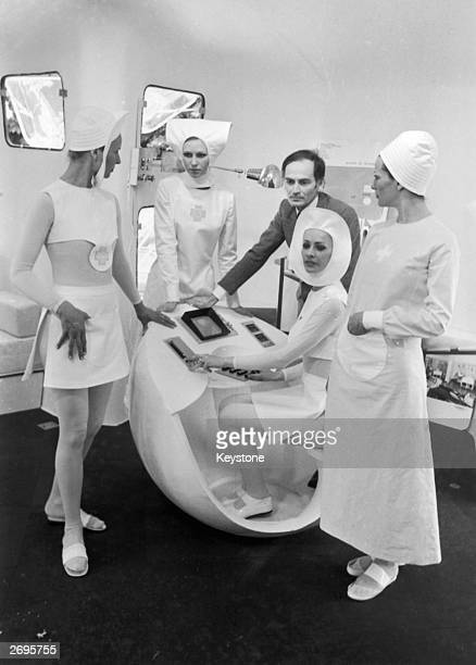 Four of the new uniforms for French nurses designed by couturier Pierre Cardin