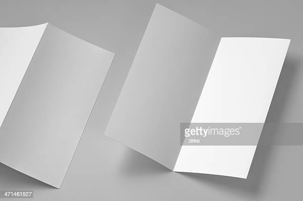 Four page, single fold, blank, white flyer on white