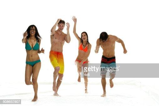 Four people dancing in the rain : Stock Photo