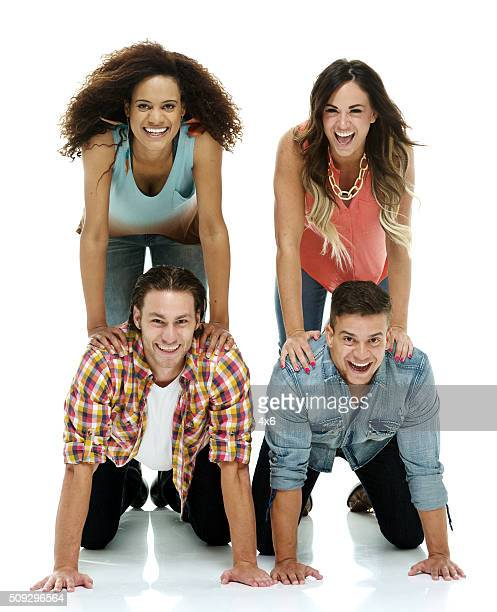 Four people doing a human pyramid