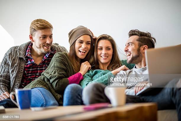 Four people enjoying multimedia content